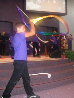 Child uses flags for worship