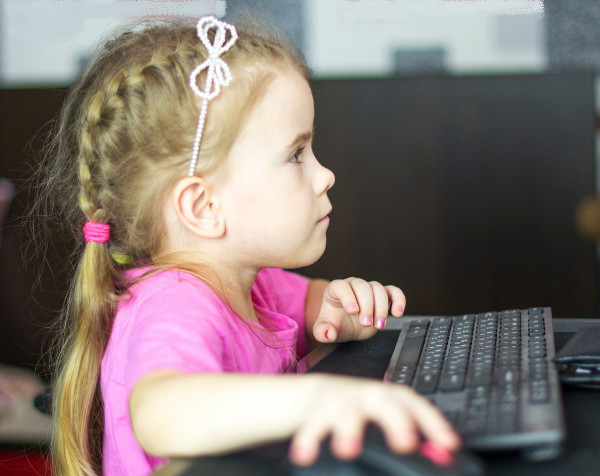 Young girl uses computer